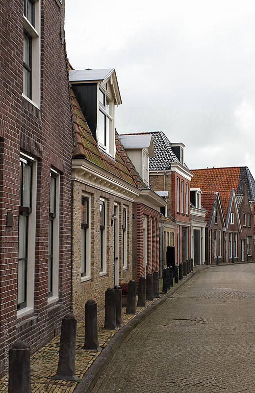 Typical dutch smalltown street by Marcel for Stocksy United