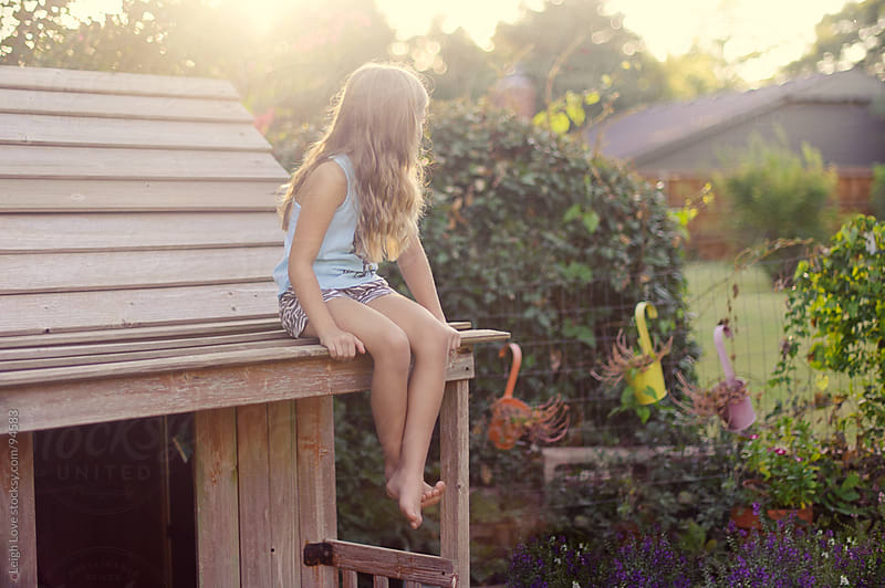 Young Girl with Blonde Hair Sits Sits on Roof of Playhouse by Leigh Love for Stocksy United