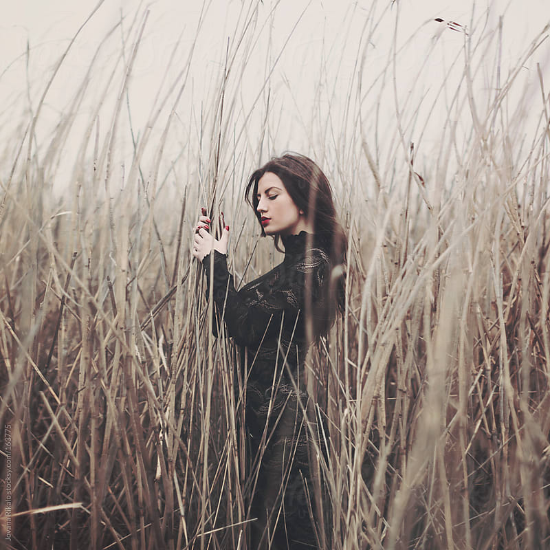 Girl in a field by Jovana Rikalo for Stocksy United