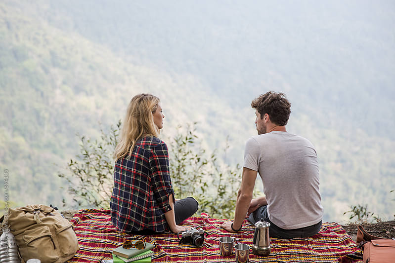 Couple having a picnic at the top of the mountain by Jovo Jovanovic for Stocksy United