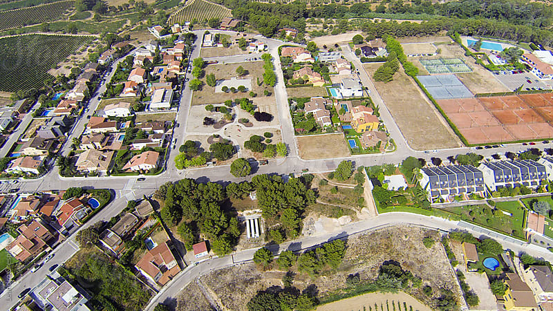 Aerial view of a rural town  by Leandro Crespi for Stocksy United