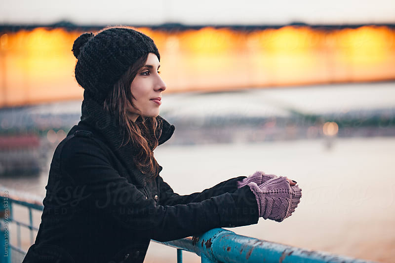 Smiling Woman Standing on the Bridge in Winter by Lumina for Stocksy United