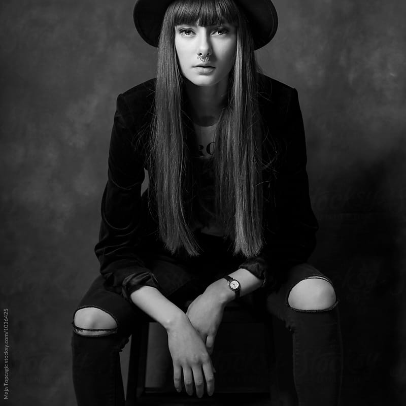 Fashion portrait in the studio  by Maja Topcagic for Stocksy United