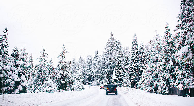 A snow covered highway en route to the mountains. by Danny Pellissier for Stocksy United
