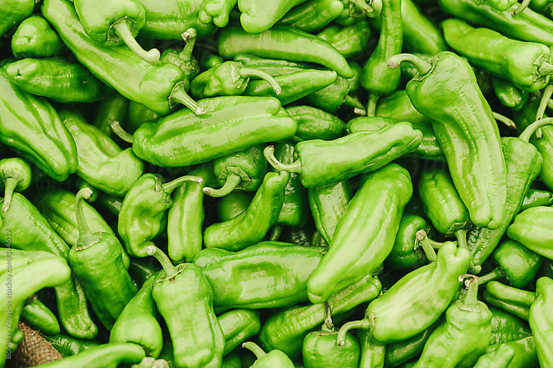 Fresh green peppers in the market. by Borislav Zhuykov for Stocksy United