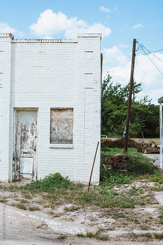 old abandoned white brick house by Image Supply Co for Stocksy United