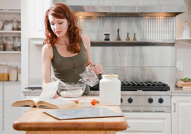 Young woman baking in kitchen by Andersen Ross Photography for Stocksy United