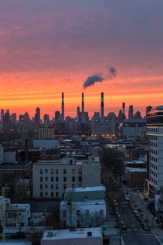 New York City at Sunset - View from Long Island City towards Manhattan by Tom Uhlenberg for Stocksy United