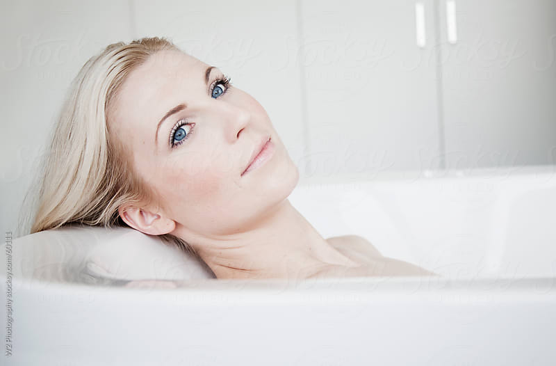 Beautiful woman realaxing in a bath. by W2 Photography for Stocksy United