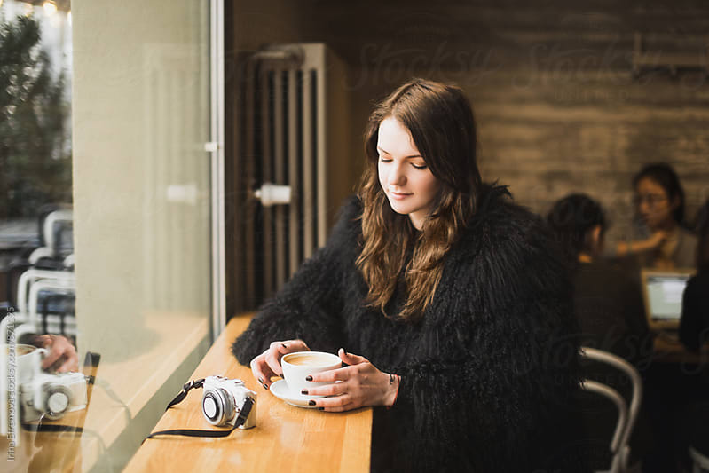 Girl with a cup of coffee by Irina Efremova for Stocksy United
