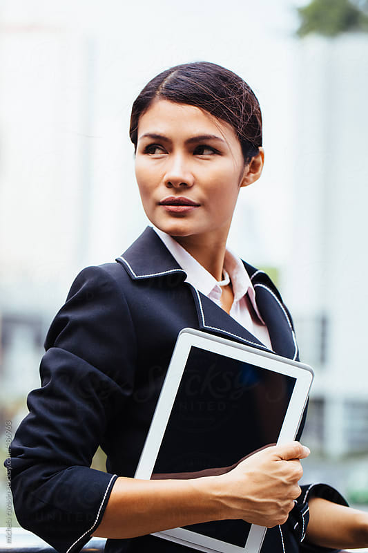 Business woman with her digital tablet by michela ravasio for Stocksy United