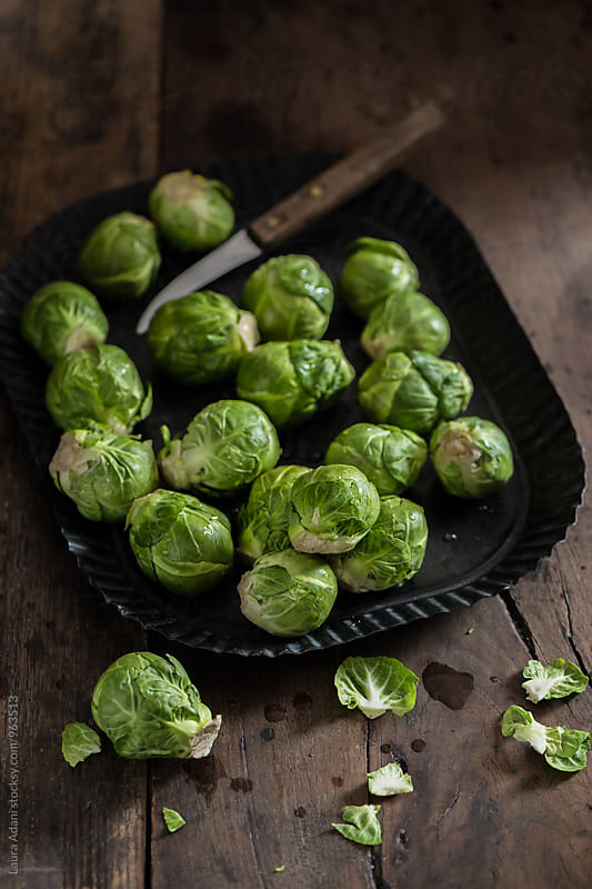 Brussel sprouts on a metal tray by Laura Adani for Stocksy United