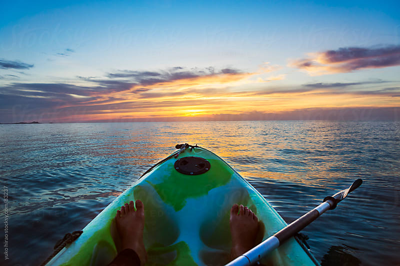 Sunset kayaking in ocean by yuko hirao for Stocksy United