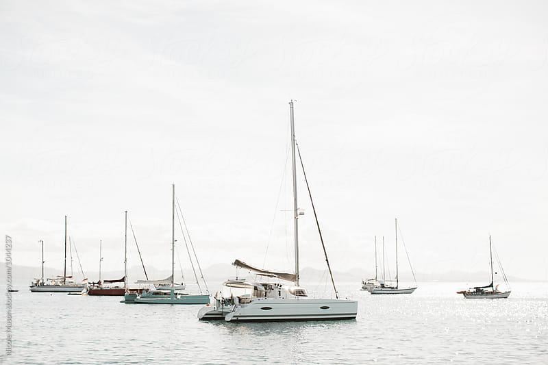 sailboats in the ocean in the canary islands by Nicole Mason for Stocksy United