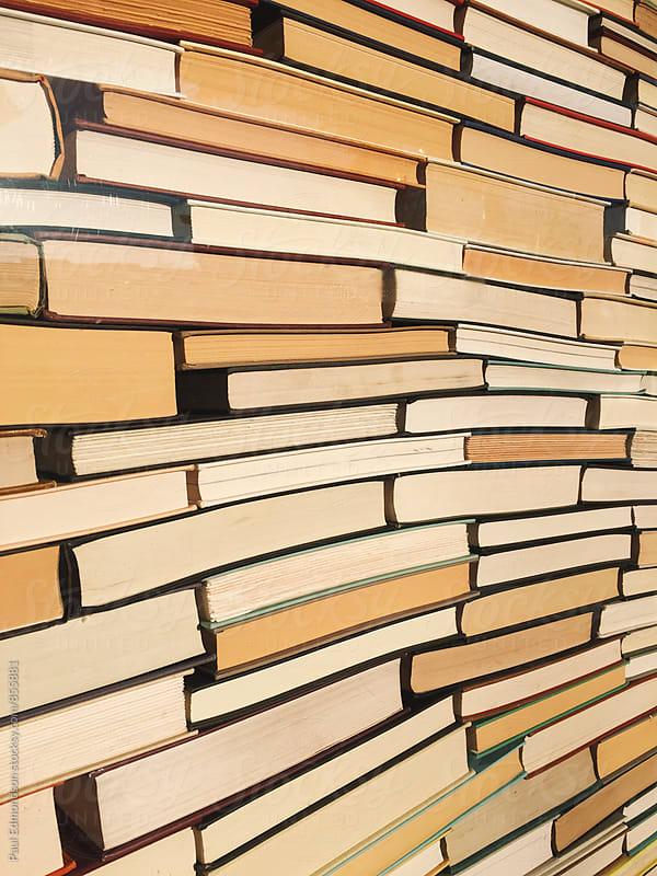 Stack of books by Paul Edmondson for Stocksy United