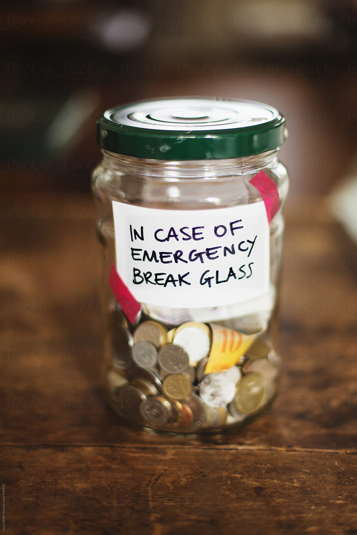 Money Saving In Jar With Label Saying In Case Of Emergency Break