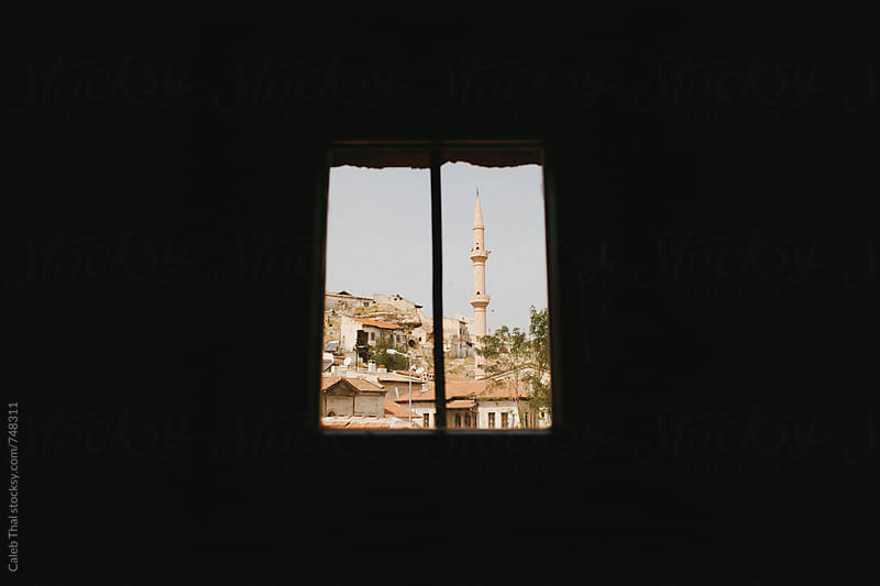 Minaret seen through a Window by Caleb Thal for Stocksy United
