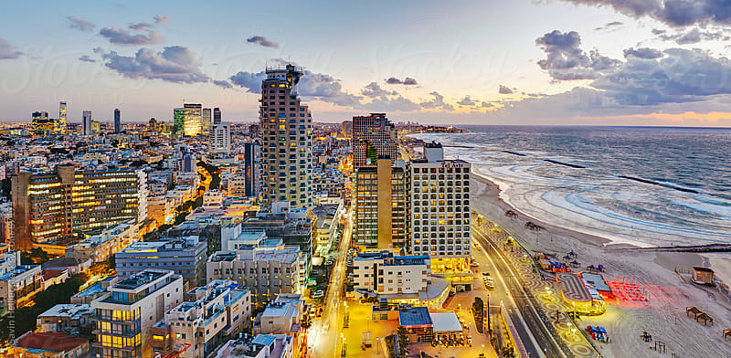 Middle East, Israel, Tel Aviv, elevated dusk view of beachfront hotels and coastline by Gavin Hellier for Stocksy United