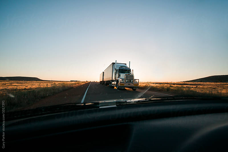A big truck driving through the desert by Gary Parker for Stocksy United