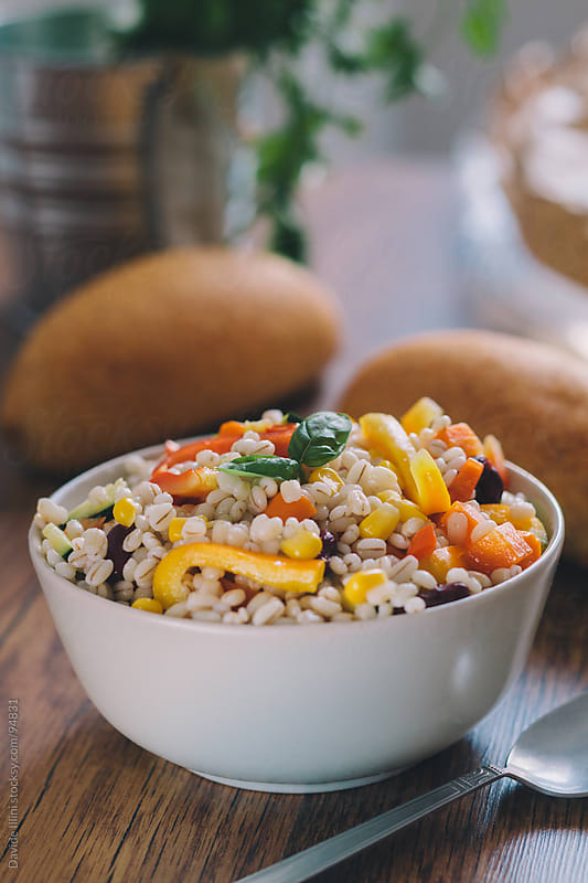 Barley salad with fresh vegetables by Davide Illini for Stocksy United