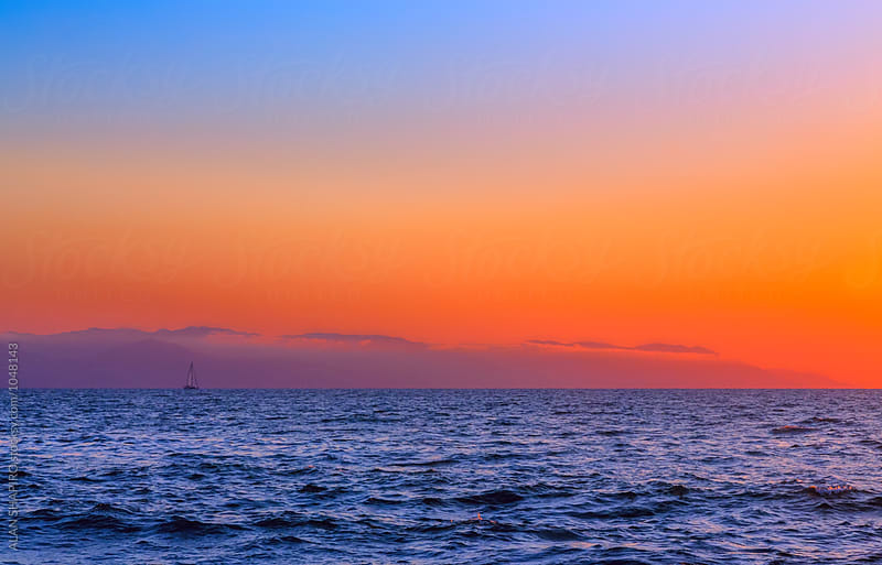 sailboat at sunrise by alan shapiro for Stocksy United