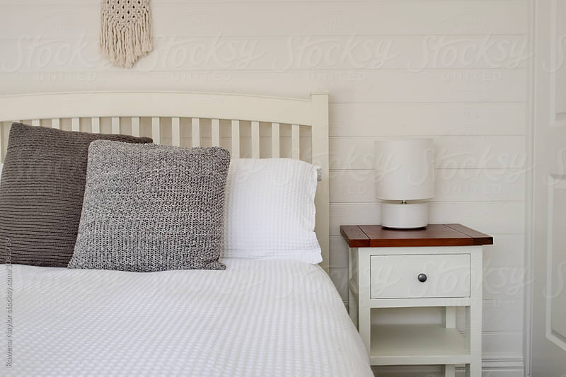 White bedroom interior by Rowena Naylor for Stocksy United