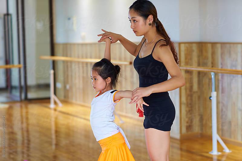 young asian dancing teacher teach her student dance indoor