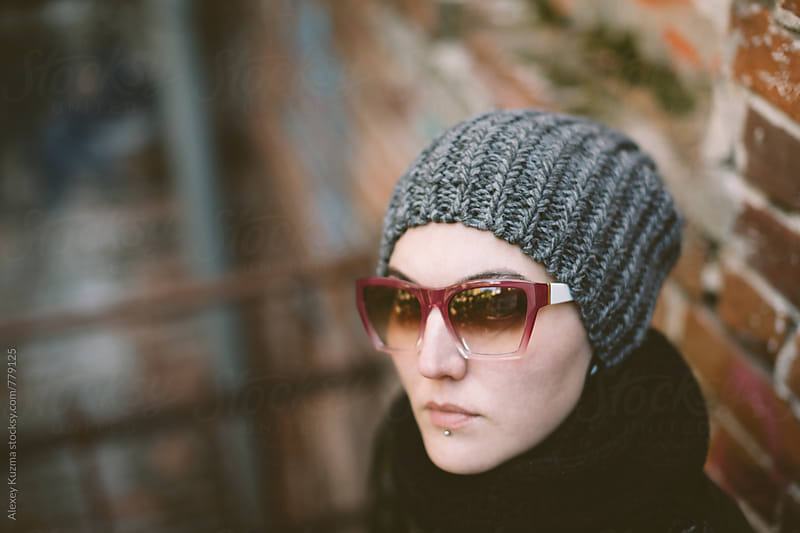 androgyne on the street  by Vesna for Stocksy United