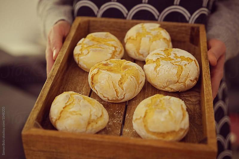 Fresh baked rolls by Simon Bolz for Stocksy United