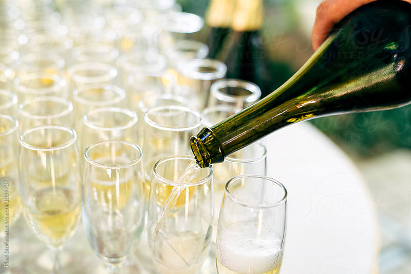 Pouring champagne by Pixel Stories for Stocksy United