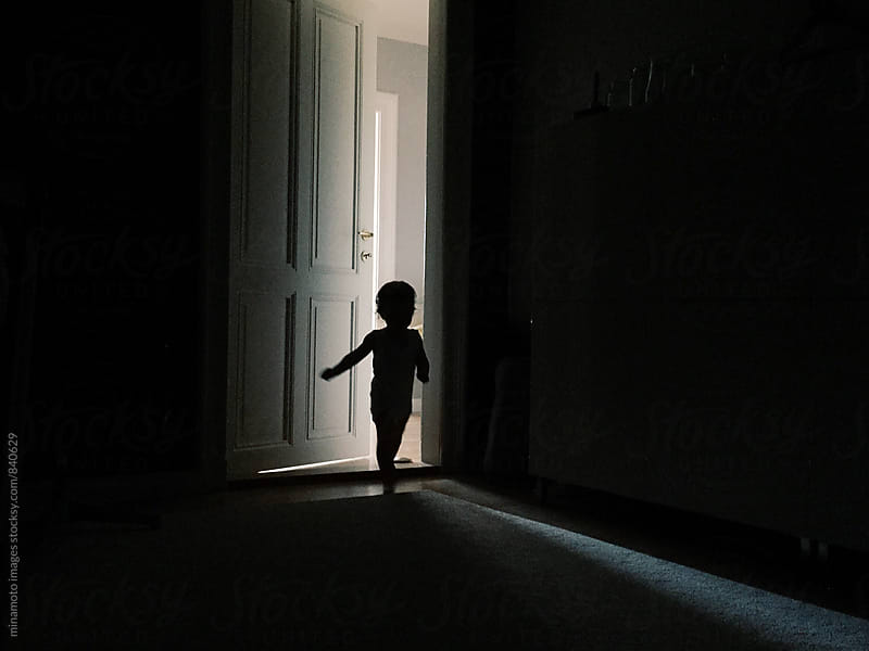 Little toddler running into dark room by minamoto images for Stocksy United