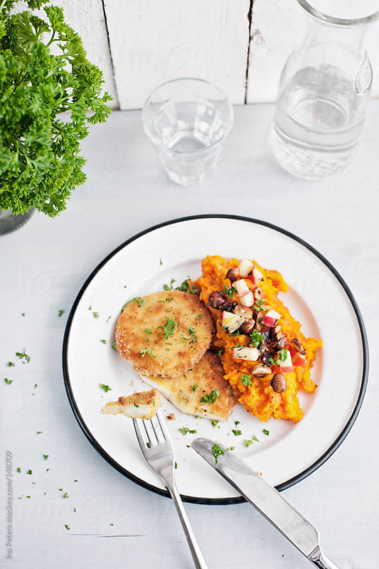 Food: Vegatarian Dish, Celery Schnitzel with Mashed Pumpkin  by Ina Peters for Stocksy United