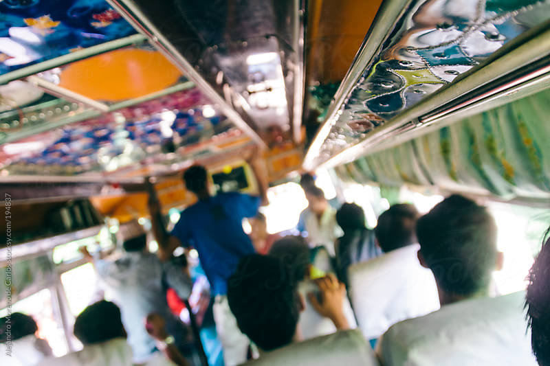People travelling on a colourful bus in India by Alejandro Moreno de Carlos for Stocksy United