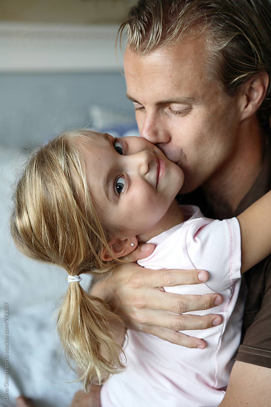 Daddy Kissing Daughter With Ponytails by Dina Giangregorio for Stocksy United