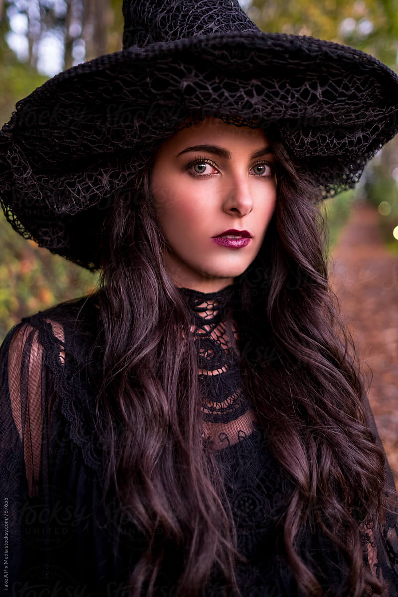 Beautiful Woman In Witch Costume Celebrating Halloween By Take A Pix Media Halloween Woman Stocksy United