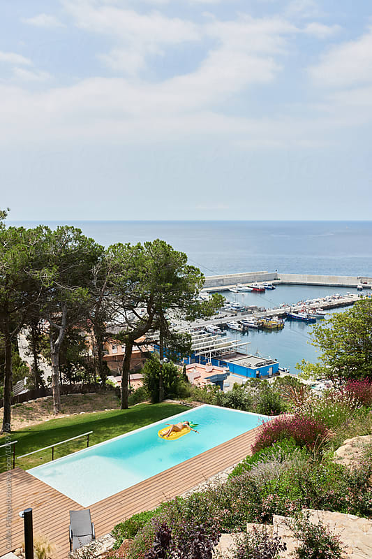 Amazing seaview with swimming pool in trees by Guille Faingold for Stocksy United