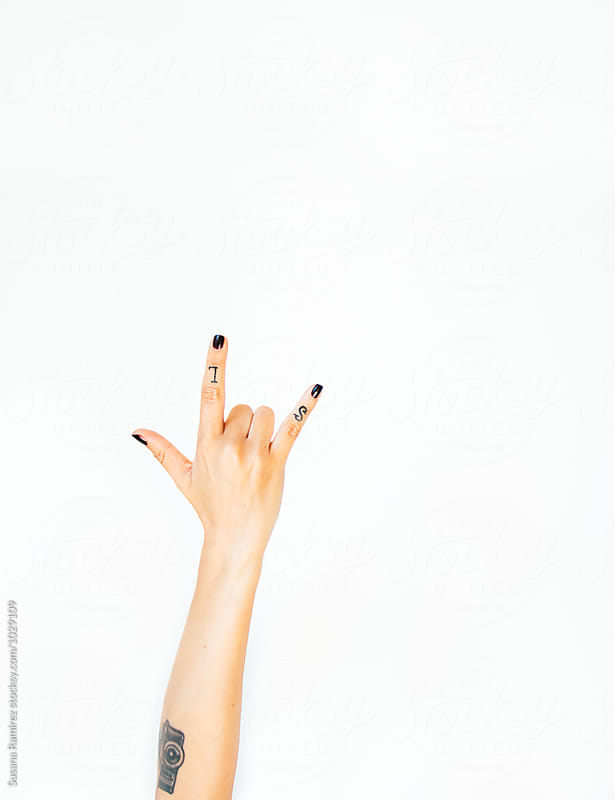 Horns hand sign by Susana Ramírez for Stocksy United