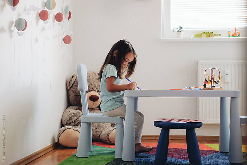 Little Girl Colouring in her Playroom by Mosuno for Stocksy United
