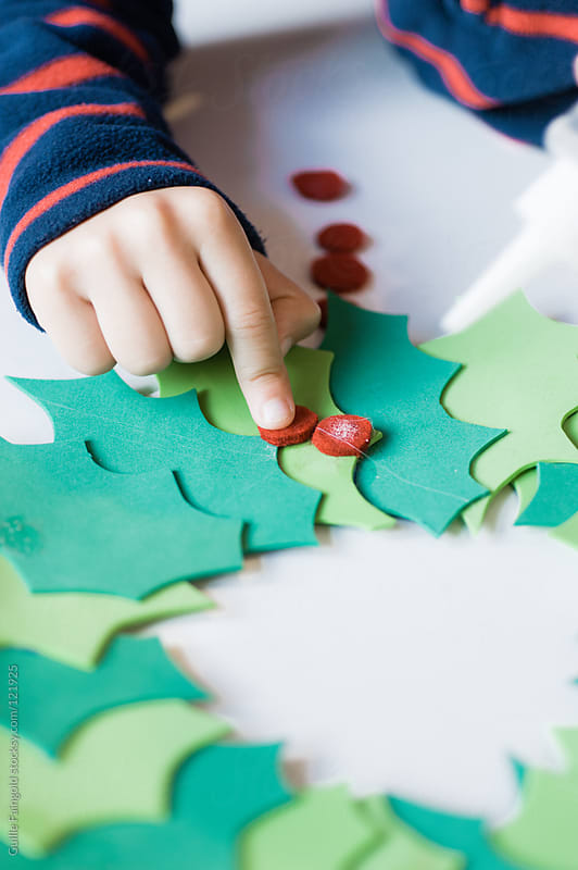 Little boy making Christmas decoration craft by Guille Faingold for Stocksy United