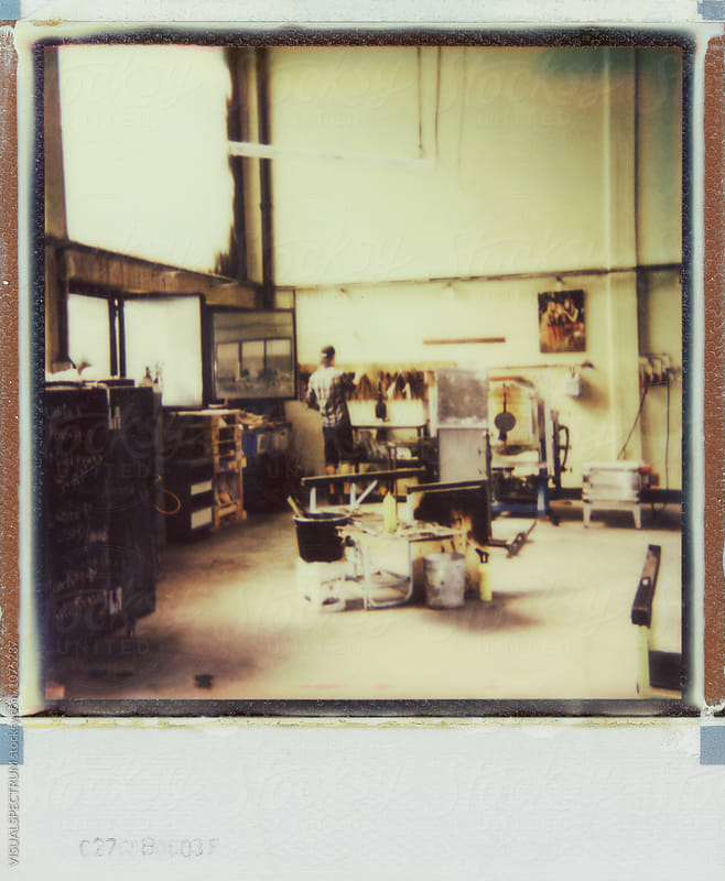 Polaroid of Man Working in Artisan Glass Workshop by Julien L. Balmer for Stocksy United
