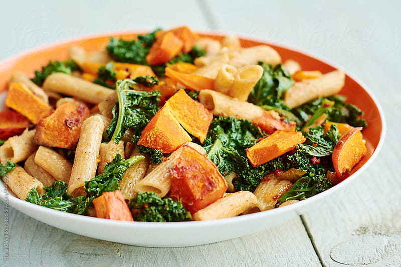 Wholewheat Pasta with Kale and Squash by Harald Walker for Stocksy United