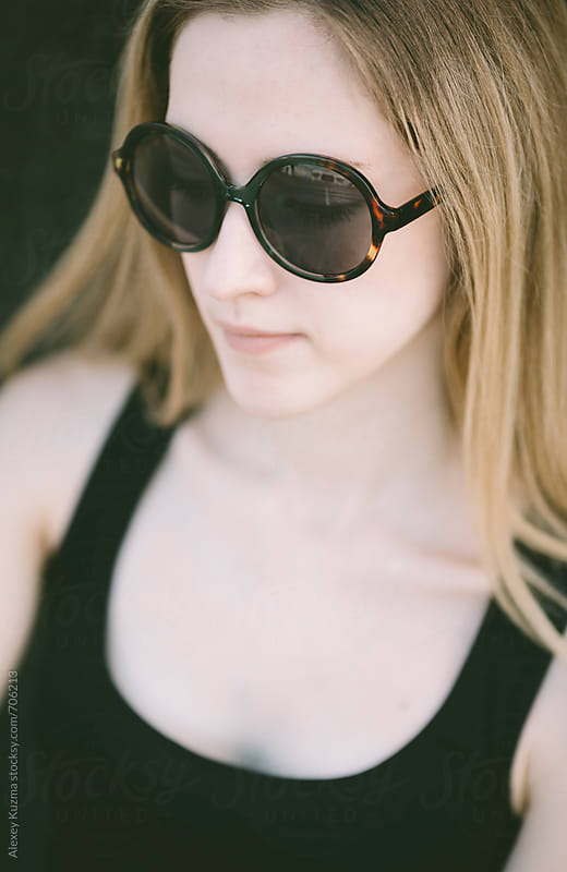 portrait of real young woman with round vintage sunglasses. by Alexey Kuzma for Stocksy United