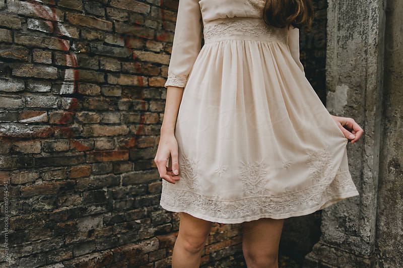 Attractive girl in vintage dress  by Ryan Ahern for Stocksy United