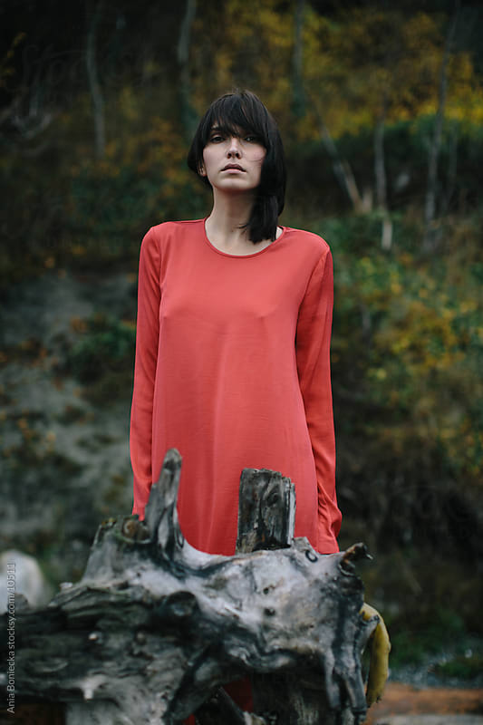 A portrait of a woman in a red dress by Ania Boniecka for Stocksy United