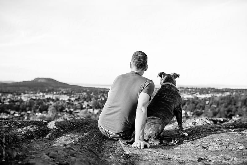 Man's love for his dog by Helene Cyr for Stocksy United