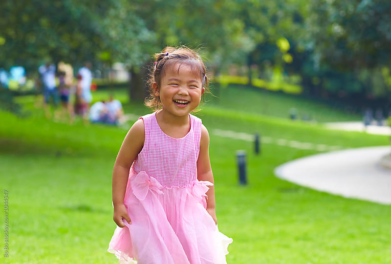adorable little asian girl outdoor by Bo Bo for Stocksy United