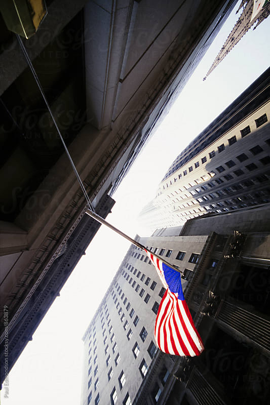 Wall Street buildings and American Flag, NY, NY, USA by Paul Edmondson for Stocksy United