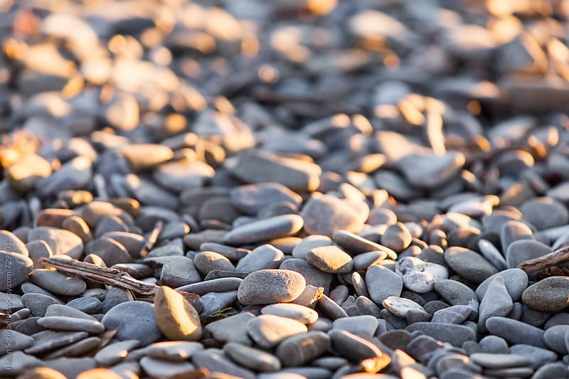 Pebbles on the Beach by Helen Sotiriadis for Stocksy United