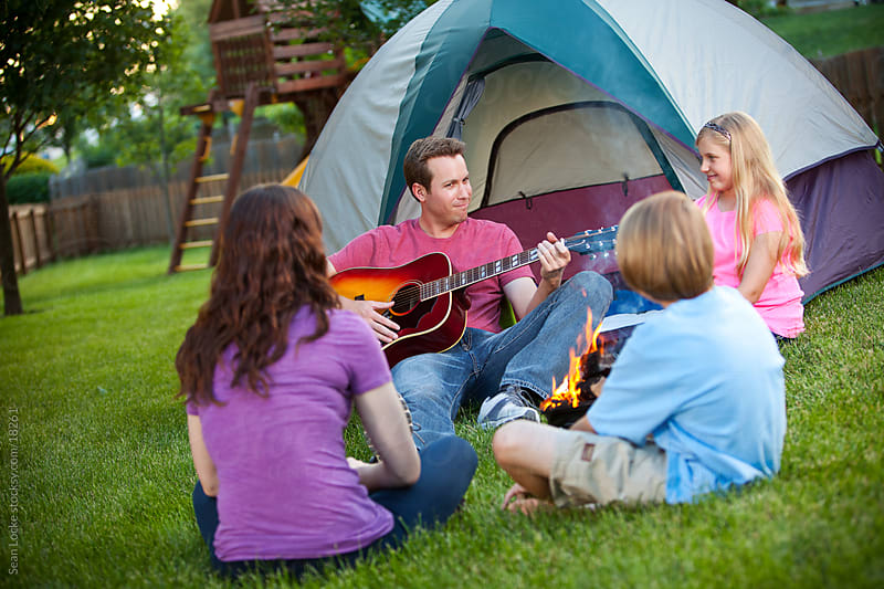 Camping: Dad Starts Family Sing-a-long by Sean Locke for Stocksy United