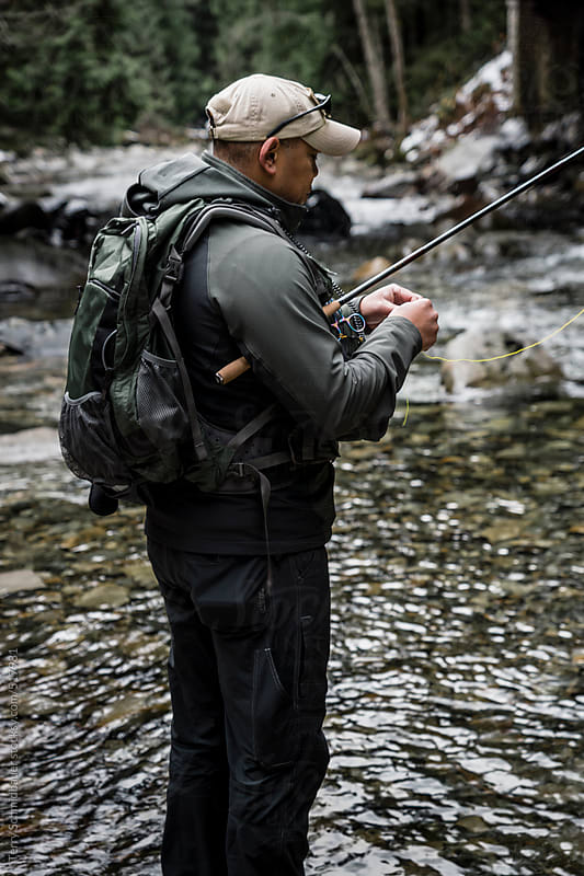 Winter Fly Fishing by Terry Schmidbauer for Stocksy United
